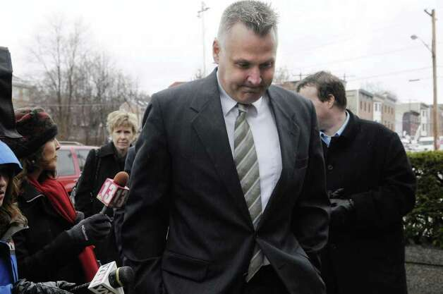 Suspended Albany detective James Miller,  makes his way into Albany City Court on Monday, March 21, 2011, for his arraignment on charges of driving while intoxicated.  Miller, a  longtime spokesman for the Albany Police Department, was pulled over Friday night.  (Paul Buckowski / Times Union) Photo: Paul Buckowski  / 00012473A