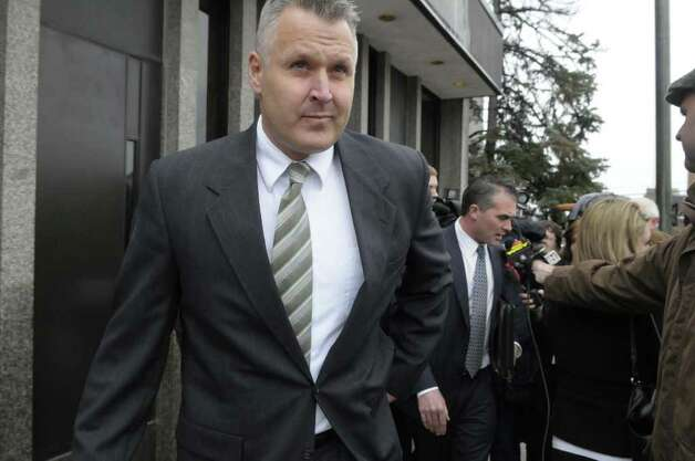 Suspended Albany detective James Miller, exits Albany City Court on Monday, March 21, 2011, following his arraignment on charges of driving while intoxicated.  Miller, a  longtime spokesman for the Albany Police Department, was pulled over Friday night.  (Paul Buckowski / Times Union) Photo: Paul Buckowski  / 00012473A