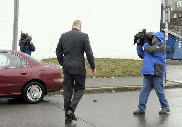 Suspended Albany detective James Miller, exits Albany City Court on Monday, March 21, 2011, as television crews follow him, after his arraignment on charges of driving while intoxicated.  Miller, a  longtime spokesman for the Albany Police Department, was pulled over Friday night.  (Paul Buckowski / Times Union) Photo: Paul Buckowski  / 00012473A