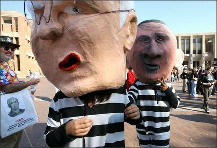"""As at most major political protests in Seattle, like this one in October, there are huge bobbing papier-mâché heads of George Bush, Dick Cheney, Condoleezza Rice and Donald Rumsfeld on top of bodies clad in black-and-white prison suits. They're """"the chain gang,"""" the icons of the local Backbone Campaign. Photo: P-I FILE/2006"""