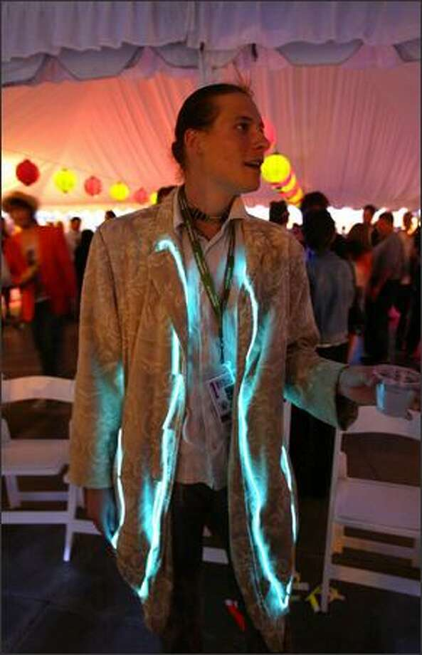 Aries Henson shows off his illuminated coat at the Seattle International Film Festival opening gala at McCaw Hall. Photo: Joshua Trujillo/Seattle Post-Intelligencer