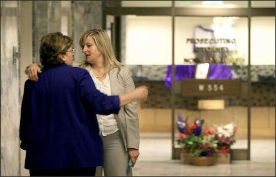 Maureen Galloway, left, legal services manager, and Cheryl Snow, senior deputy prosecutor, console each other at the courthouse Friday. Photo: Dan DeLong/Seattle Post-Intelligencer