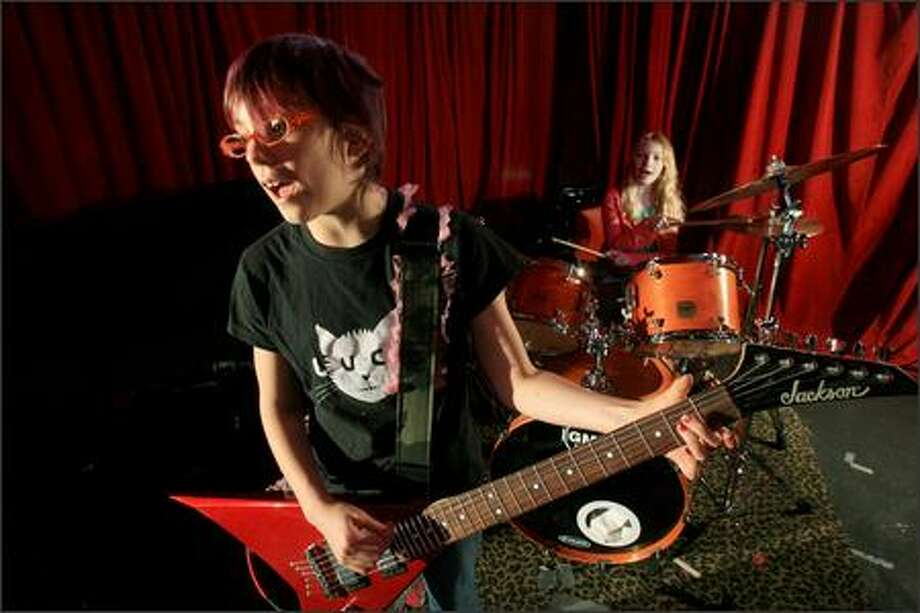 Amelia, 10, of Portland, foreground, and Bella of Vancouver, B.C., rehearse at Chop Suey in Seattle on Friday. The young guitar-drummer pair, who make up the band King, will perform Saturday at the rock club. Photo: Dan DeLong/Seattle Post-Intelligencer