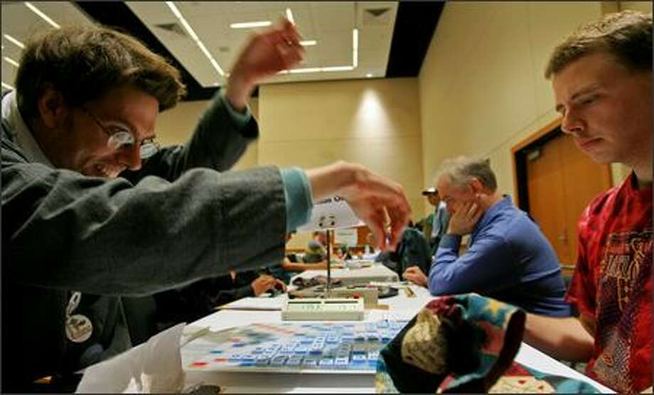 "An enthusiastic Daniel Goodwin of Montlake spells ""nisei"" and scores 41 points against Dave Wiegand of Portland during Seattle Scrabble Club's annual tournament in Lynnwood on Sunday. Wiegand defeated Goodwin 419-415. Photo: Dan DeLong/Seattle Post-Intelligencer"