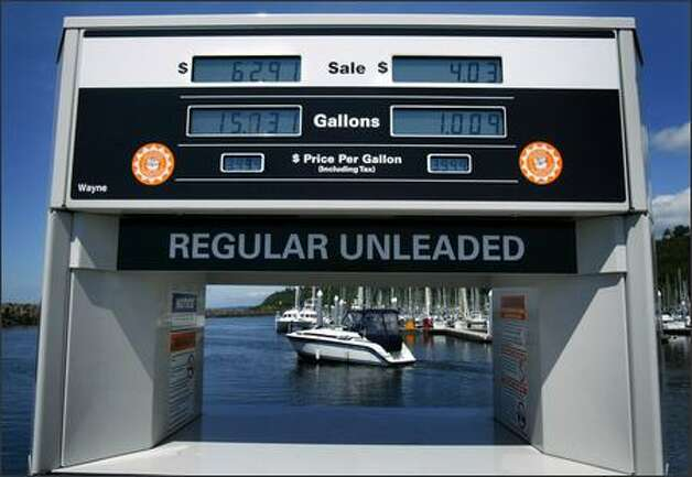 "Regular unleaded was just shy of $4 a gallon Monday at the Shilshole Bay Marina Fuel Dock. The high prices have prompted some boating enthusiasts to limit outings. ""The prices are definitely outrageous,"" said powerboat owner Mohamed Lahlou. Photo: Joshua Trujillo/Seattle Post-Intelligencer"
