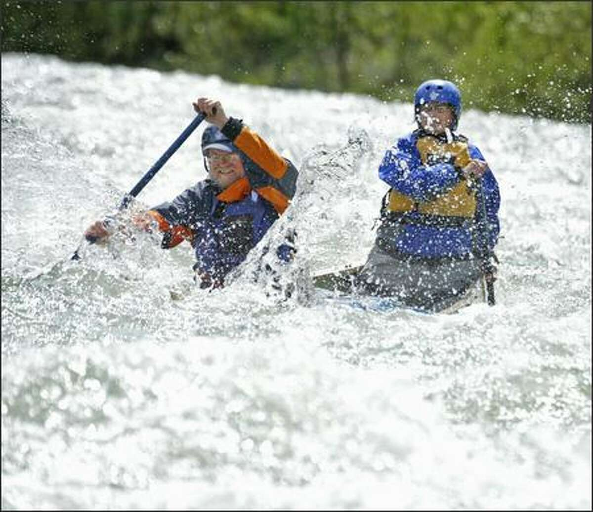 Jim and Kathy Greenleaf work the rapids on the Middle Fork. Flotation bags in the canoe keep it afloat if swamped.