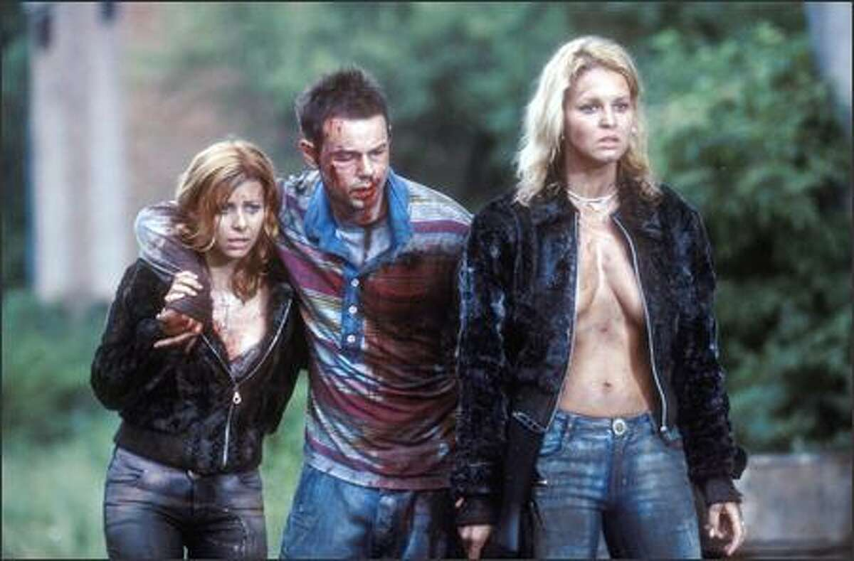Things don't go as planned for employees (from left, Judit Viktor, Danny Dyer and Juli Drajko) on a corporate team-building retreat.