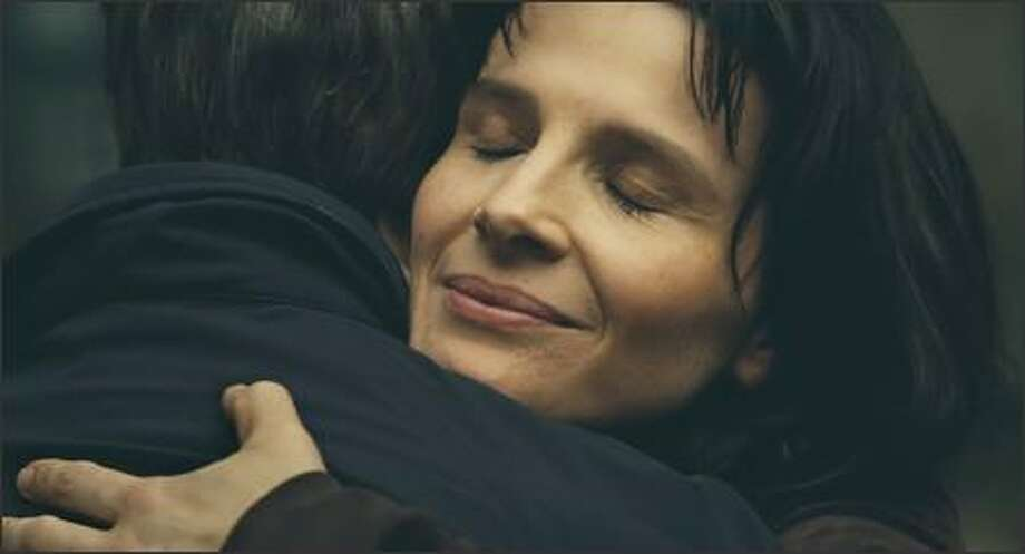 "Suzanne (Juliette Binoche) is a mourning mother in Nobuhiro Suwa's ambitious ""Place des Victoires."" Photo: /"