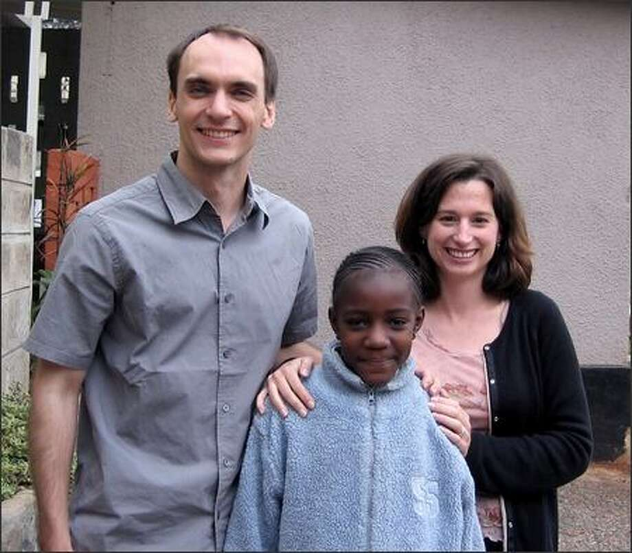 UW medical students Kevin McKenzie and Robyn Rogers stand with Eunice, who tested positive for HIV. Photo: /