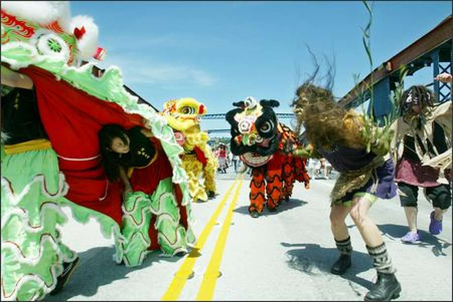 Fremont celebrated the reopening of the Fremont Bridge to regular service in typical fashion, with Chinese lion dancers and trolls facing off on the span. Photo: Paul Joseph Brown/Seattle Post-Intelligencer