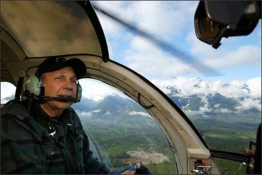 Anthony Reece, who has been flying for more than 50 years, heads to a commercial job transporting cedar from the North Cascades. Photo: Karen Ducey/Seattle Post-Intelligencer