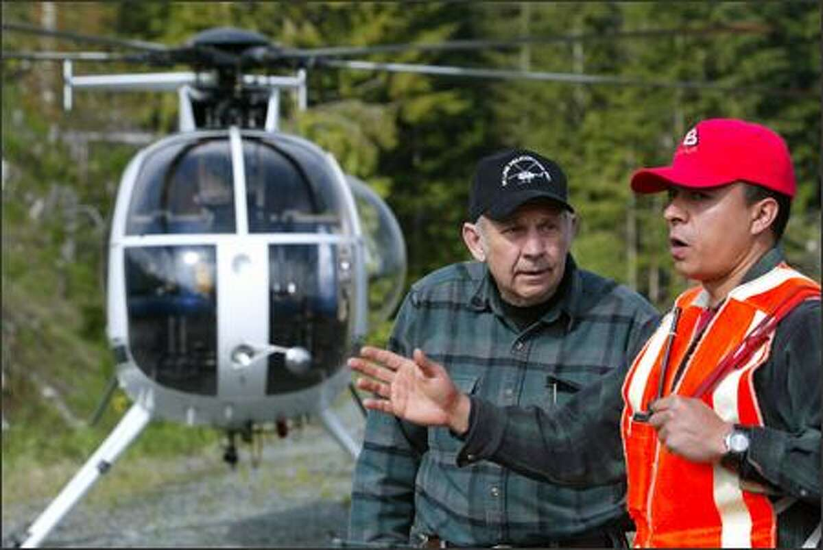 Reece was working with Jose Acuna when his helicopter crashed in January, almost crushing the salvage logger he had worked with for 10 years. On May 22, the two work together on a long-line operation for the first time since the accident.