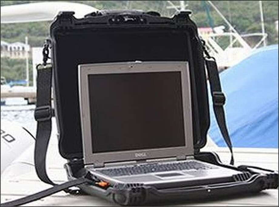 A computer fits securely inside Otter Products' Rugged Laptop Carrying Case. Photo: /