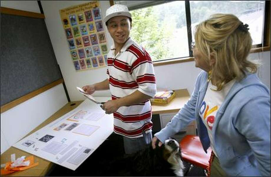 Josh Arsenaux, 18, talks about his nearly completed senior project Wednesday with Susi Wight, the program director for his school, Project Hope in Bothell. Arsenaux will graduate Tuesday. Photo: Andy Rogers/Seattle Post-Intelligencer