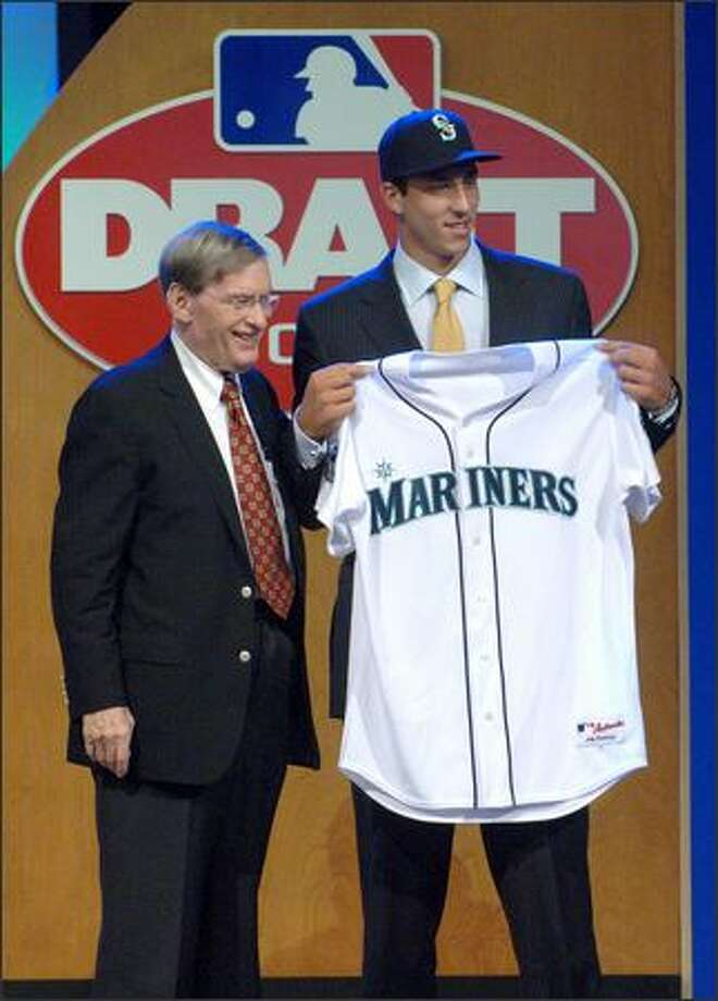 "Baseball Commissioner Bud Selig poses with Phillippe Aumont, whom the Mariners drafted Thursday. ""He's a very special person,"" a Seattle scout said of Aumont. Photo: / Associated Press"