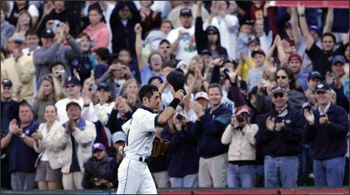 Ichiro Suzuki waves his cap to fans as he leaves the field during a game at Safeco Field late in the 2004 season. Many Mariners fans would relish the chance to see Ichiro play his entire big league career here.