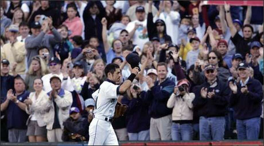 Ichiro Suzuki waves his cap to fans as he leaves the field during a game at Safeco Field late in the 2004 season. Many Mariners fans would relish the chance to see Ichiro play his entire big league career here. Photo: / Associated Press