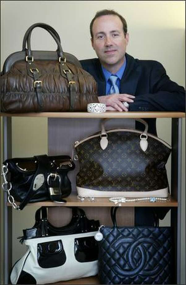 Michael Smith's Bag Borrow or Steal, a Netflix-style business, allows customers to borrow bags and jewelry. Photo: Joshua Trujillo/Seattle Post-Intelligencer