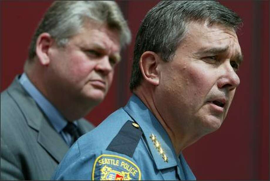 With Seattle Mayor Greg Nickels backing him, police Chief Gil Kerlikowske answers questions Tuesday about his role in an investigation into purported misconduct by two Seattle police officers. Photo: Paul Joseph Brown/Seattle Post-Intelligencer