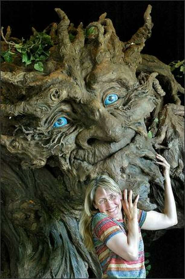 "Artist Kim Graham's ""Jotuntre,"" Norwegian for King of the Trees, built for the Fremont Solstice Parade, was modeled after her late father Hezzie Strombo. Photo: Mike Urban/Seattle Post-Intelligencer"