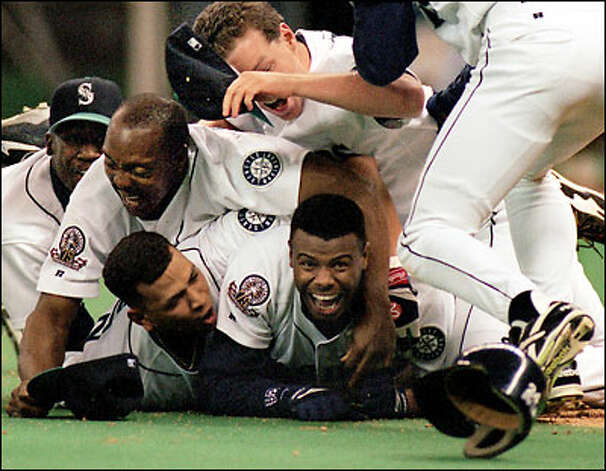 Ken Griffey Jr. drew quite a crowd after scoring the winning run against the Yankees in the 1995 American League Division Series. Photo: P-I File