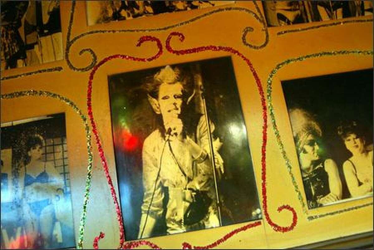"""An old poster bearing pictures of """"Ze Whiz Kids"""" -- a drag queen, cabaret and performance art group -- hangs in the Double Header bar in Seattle. The tavern, which first opened in the 1930s, has a rich history of providing a venue for transvestites in the 1970s. Now the tavern draws a mixture of straight people and gays."""