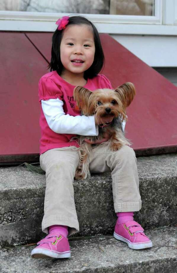Four-year-old Gigi was adopted from China by the Highlander family of Brookfield  when she was 2. Photo taken at her home in Brookfield on Thursday March 17, 2011. Photo: Lisa Weir / The News-Times Freelance