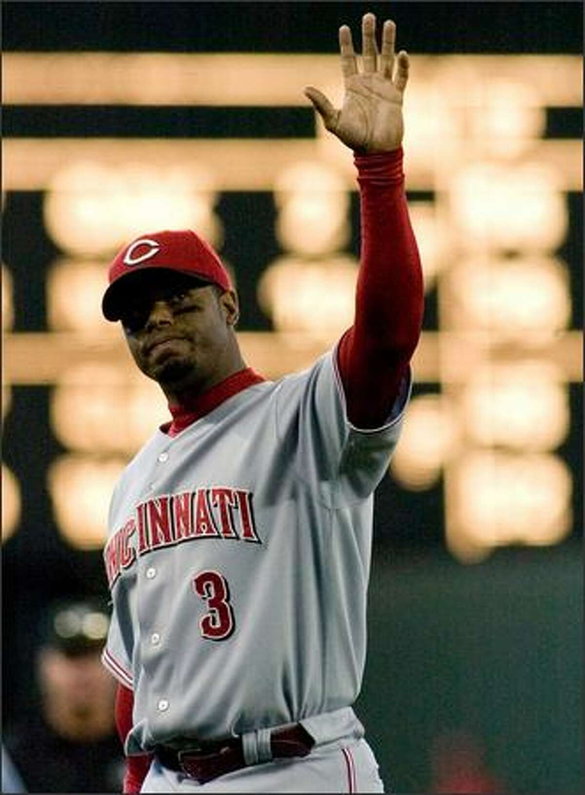 Ken Griffey Jr., waves to fans at Safeco Field after departing the field at the end of the eighth inning.