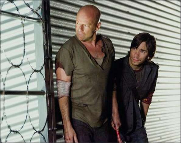John McClane (Bruce Willis) is PC and Matt Farrell (Justin Long) is Mac in the latest odd couple from Hollywood. Photo: FRANK MASI
