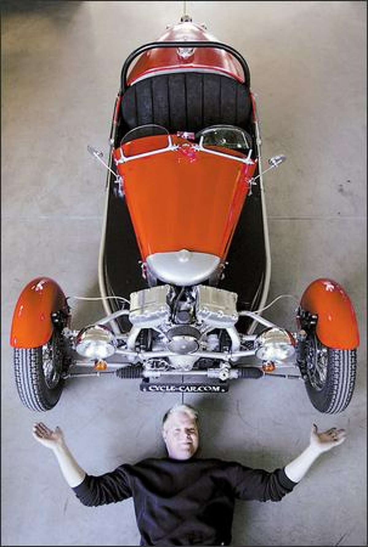 Pete Larsen displays his custom-designed, three-wheeled ACE Cycle Car, built using a Harley-Davidson engine, at his shop, Liberty Motors of Seattle. Larsen was inspired by the British-made Morgan models from the 1930s.