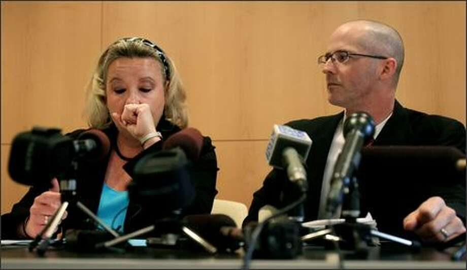Kathleen Brose, a Seattle parent and president of Parents Involved in Community Schools, is overcome with emotion during a news conference about the Supreme Court's decision that rejected diversity plans that take account of students' race for assignments in Seattle's public schools. Brose's daughter was assigned to high school based on her race and she leads the parents group that has challenged the Seattle School District's policies for six years. On right is Harry Korrell, who represents Parents Involved in Community Schools and argued the Seattle parents' case before the United States Supreme Court. Photo: Dan DeLong/Seattle Post-Intelligencer