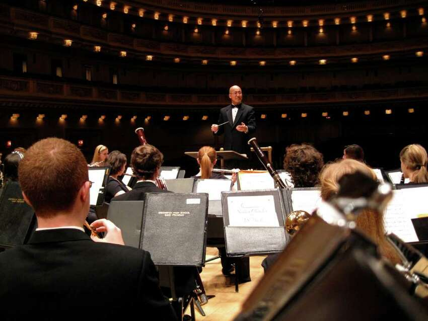Greenwich High School Director of Bands John Yoon leads the school's wind ensemble in a performance on Sunday, March 21, 2011, at Carnegie Hall in New York as part of the
