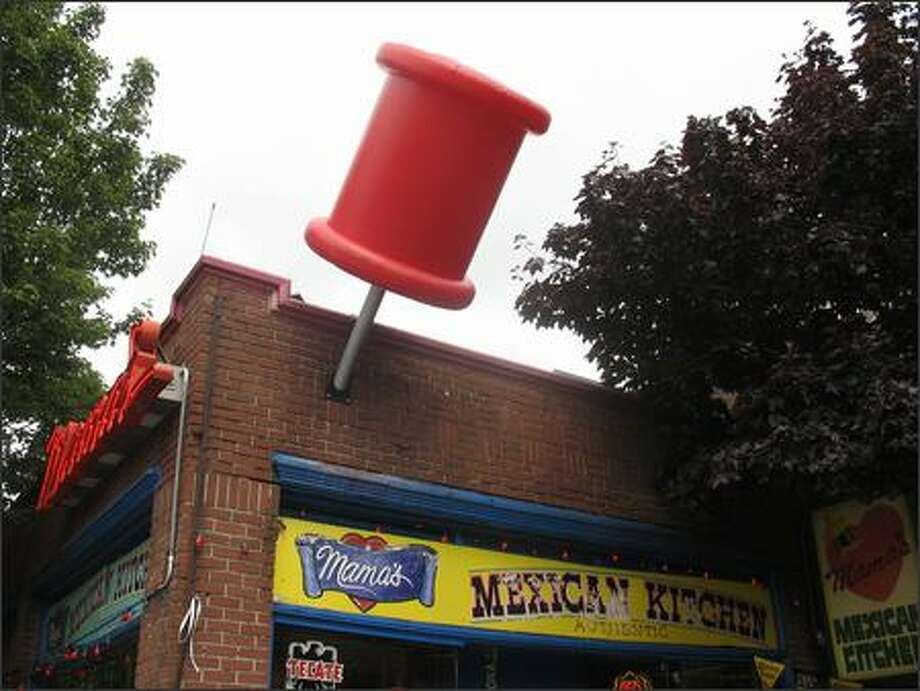 The giant red pushpin at Mama's Mexican Kitchen in Belltown is helping Microsoft market its custom mapping feature. Photo: Todd Bishop/Seattle Post-Intelligencer