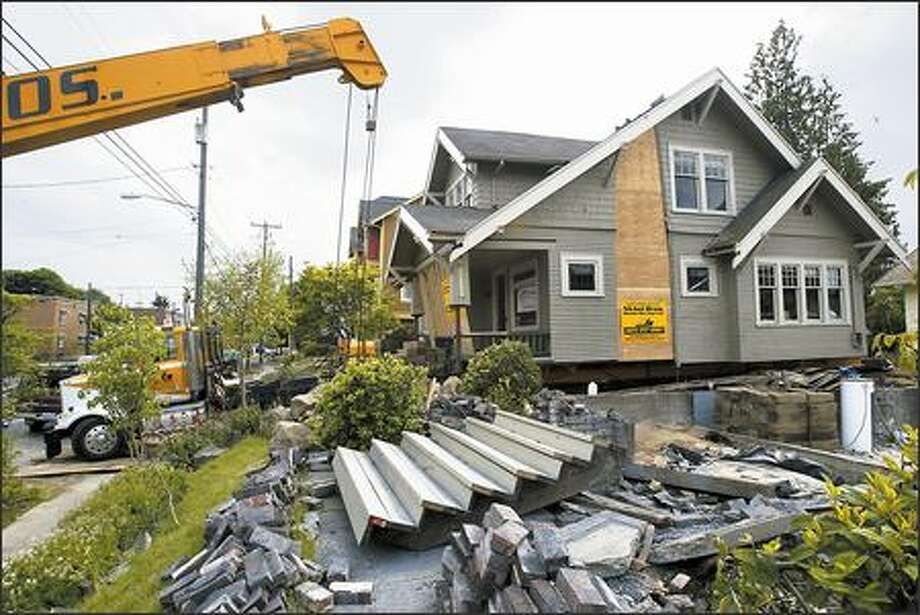 Frank-Michael Rebhan bought this 1917 Craftsman house -- slated for demolition -- for $1, then had it moved to his Phinney Ridge property five blocks away. Photo: Andy Rogers/Seattle Post-Intelligencer