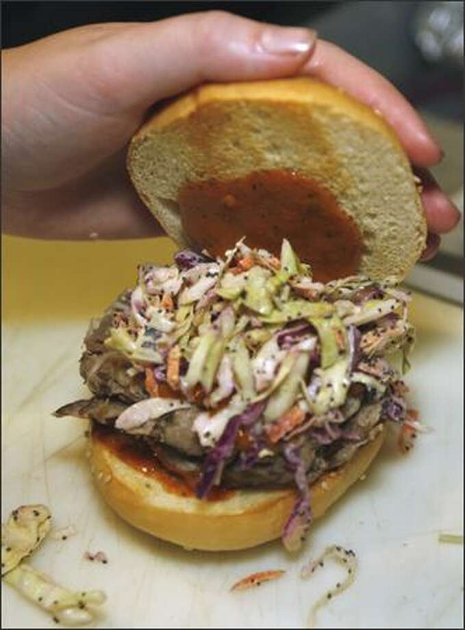 A Georgia Gold Smokin Sandwich (pork with mustard, barbecue sauce and cole slaw) is $6 at Roy's in Columbia City. Photo: Grant M. Haller/Seattle Post-Intelligencer