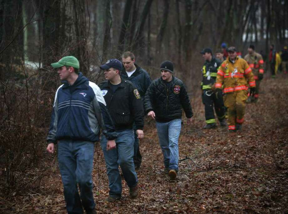Firefighters search the woods near Dogwood Road in Orange for missing girl Isabella Oleschuk. Photo: Brian A. Pounds / Connecticut Post