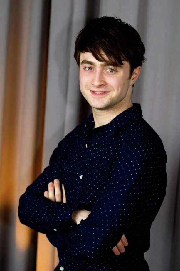 In this March 17, 2011 photo, actor Daniel Radcliffe poses for a portrait in New York. Radcliffe will be honored with the Trevor Project's Hero Award at a ceremony in New York in June, 2011.  (AP Photo/Charles Sykes) Photo: Charles Sykes