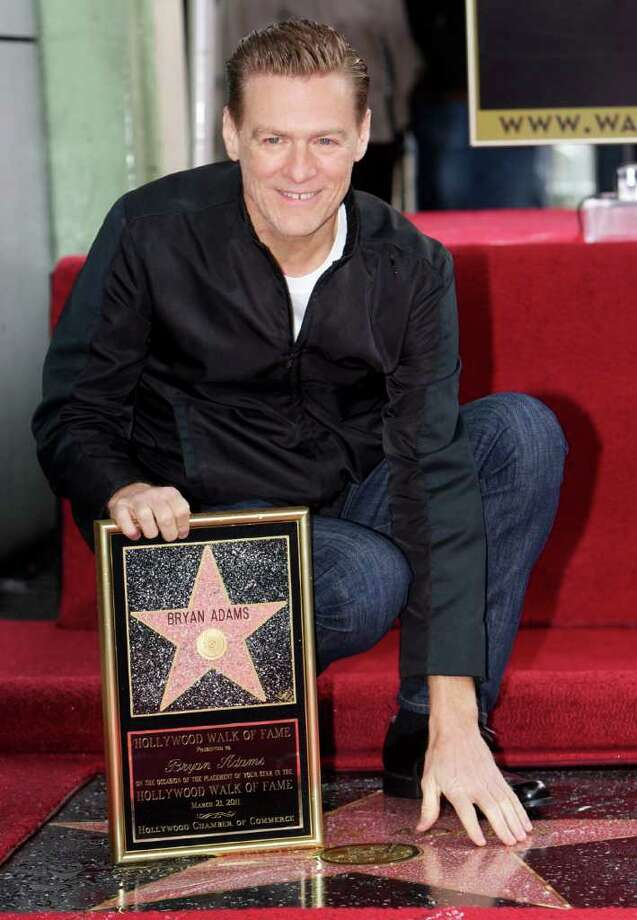 Canadian singer Bryan Adams is honored with a star on the Hollywood Walk of Fame in Los Angeles on Monday, March 21, 2011. (AP Photo/Damian Dovarganes) Photo: Damian Dovarganes