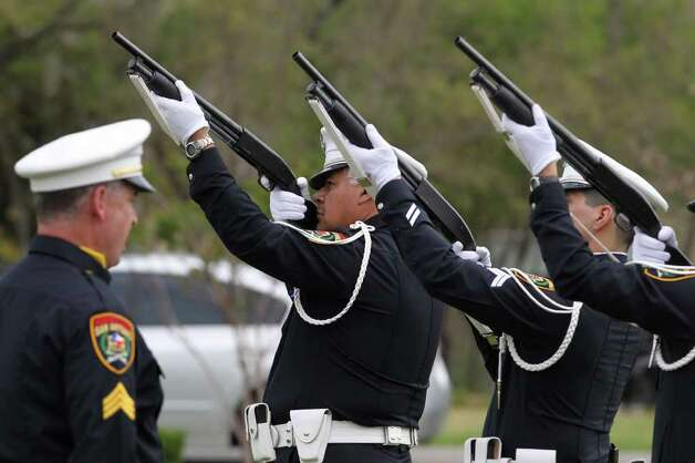 A rifle volley is fired Monday March 21, 2011 at Resurrection Cemetery during the funeral of San Antonio police officer Stephanie Brown. Brown was killed in a car accident while on duty March 15. JOHN DAVENPORT/jdavenport@express-news.net Photo: JOHN DAVENPORT, SAN ANTONIO EXPRESS-NEWS / jdavenport@express-news.net