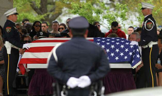 San Antonio police officer Stephanie Brown is laid to rest  in March. Brown is among those who have been killed in wrong-way vehicle crashes. Photo: San Antonio Express-News, John Davenport / jdavenport@express-news.net