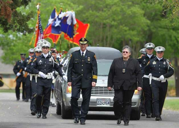 San Antonio Police Chie William McManus (front, left) and chaplain Betsy Buhler (front, right) lead a procession Monday March 21, 2011 at Resurrection Cemetery during the funeral of San Antonio police officer Stephanie Brown. Brown was killed in a car accident March 15 while on duty. JOHN DAVENPORT/jdavenport@express-news. Photo: JOHN DAVENPORT, SAN ANTONIO EXPRESS-NEWS / jdavenport@express-news.net