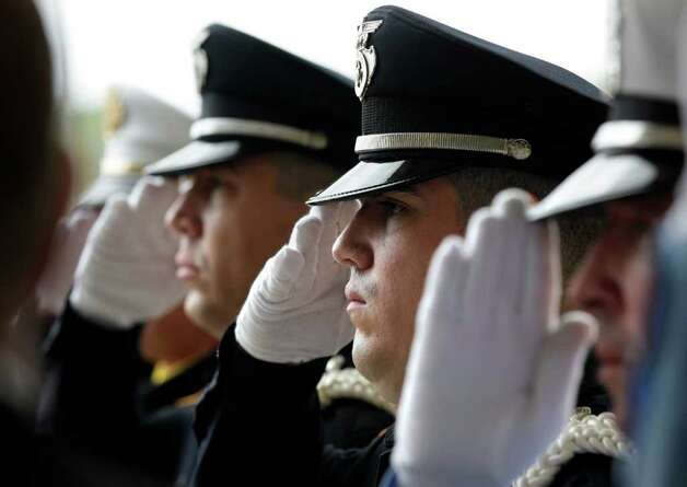 Metro daily  - Police officers salute as the casket of fallen San Antonio Police Officer Stephanie Ann Brown leaves Community Bible Church, Monday, March 21, 2011. Photo Bob Owen/rowen@express-news.net Photo: Bob Owen, San Antonio Express-News / rowen@express-news.net