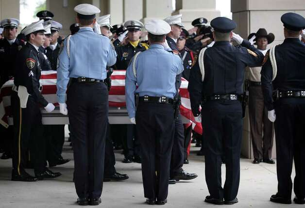 Metro daily  - Pallbearers carry the casket of fallen San Antonio Police Officer Stephanie Ann Brown from Community Bible Church, following funeral service.  Monday, March 21, 2011. Photo Bob Owen/rowen@express-news.net Photo: Bob Owen, San Antonio Express-News / rowen@express-news.net