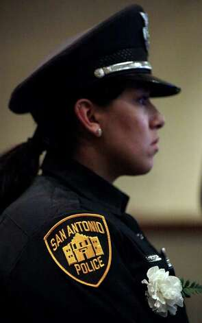 Metro daily  - Officer Alexandra Mercado, a member of the pallbearers, waits to remove the casket of fallen San Antonio Police Officer Stephanie Ann Brown from Community Bible Church, following funeral services. Monday, March 21, 2011. Photo Bob Owen/rowen@express-news.net Photo: Bob Owen, San Antonio Express-News / rowen@express-news.net