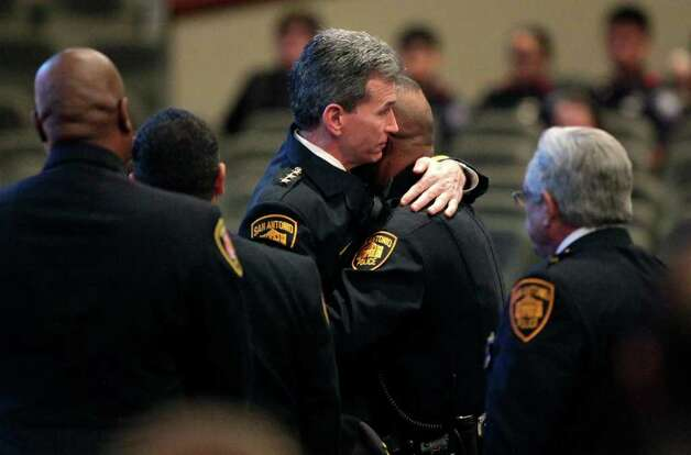 Metro daily  - San Antonio Police Chief William McManus hugs Officer Stanley Brown during the funeral service for his daughter, San Antonio Police Officer Stephanie Ann Brown, at Community Bible Church, Monday, March 21, 2011. Photo Bob Owen/rowen@express-news.net Photo: Bob Owen, San Antonio Express-News / rowen@express-news.net