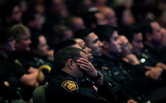Metro daily  - A San Antonio police officer grieves during the funeral service for fallen San Antonio Police Officer Stephanie Ann Brown, at Community Bible Church, Monday, March 21, 2011. Photo Bob Owen/rowen@express-news.net Photo: Bob Owen, San Antonio Express-News / rowen@express-news.net