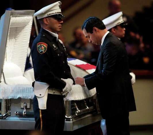 Metro daily  - San Antonio Mayor Julian Castro prays at the casket during the funeral service for San Antonio Police Officer Stephanie Ann Brown, at Community Bible Church, Monday, March 21, 2011. Photo Bob Owen/rowen@express-news.net Photo: Bob Owen, San Antonio Express-News / rowen@express-news.net
