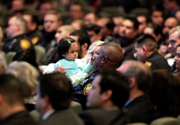 Metro daily  - Audrey Brown, 1 year old daughter of fallen police officer Stephanie Ann Brown, sits with her grandfather, SAPD's Stanley Brown, during funeral service for San Antonio Police Officer Stephanie Ann Brown, at Community Bible Church, Monday, March 21, 2011. Photo Bob Owen/rowen@express-news.net Photo: Bob Owen, San Antonio Express-News / rowen@express-news.net