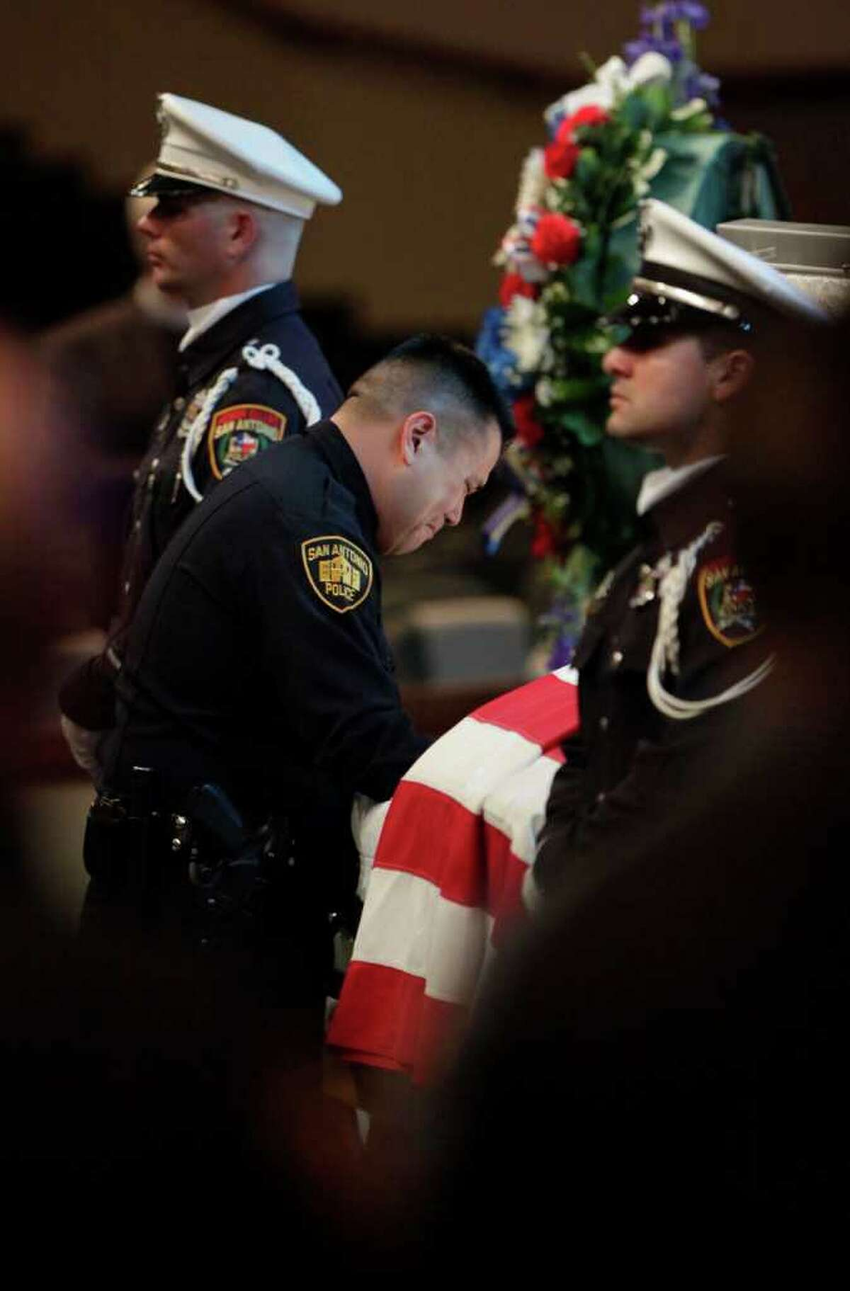 Metro daily - SAPD's Roger De La Rosa, father of Stephanie Ann Brown's daughter, pays his respects to fellow officer Brown at the funeral service for San Antonio Police Officer Stephanie Ann Brown, at Community Bible Church, Monday, March 21, 2011. Photo Bob Owen/rowen@express-news.net