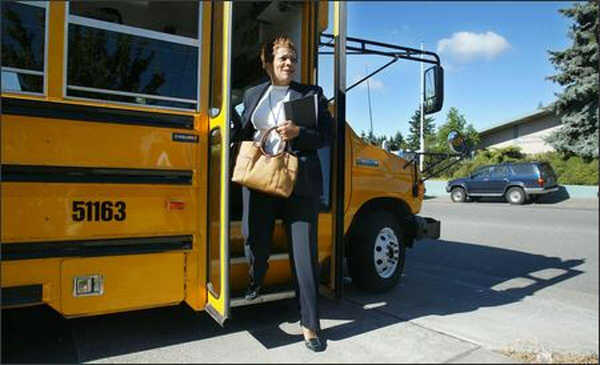 Schools superintendent Maria Goodloe-Johnson steps off the bus Monday at Northgate Elementary, her first tour stop. The tours were the first step in developing a comprehensive plan for Seattle schools.